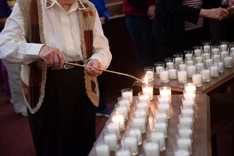 Candles are lit during the service.