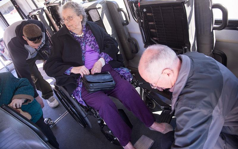<p>Paul Larzelere and Fred Proietti help Helen Stewart onto the Sunday Bus following Mass at St. Michael Church in Penn Yan April 22. (Courier photo by John Haeger)  </p>