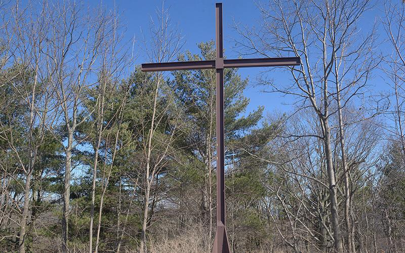 <p>This 25-foot steel cross in Wayland is the final destination for an outdoor Stations of the Cross that takes place annually on Good Friday. (Courier photo by John Haeger)  </p>