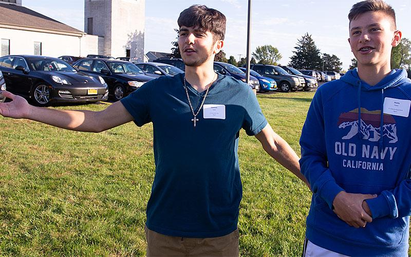 Dominic Lippa and Avery Fedor take part in an ice breaker activity Oct. 20 after a Mass at St. Jude the Apostle Church in Gates for the youths and chaperones who will be attending the National Catholic Youth Conference in November.