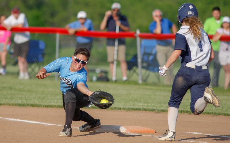 Bishop Kearney's Christina Aldridge (1) reaches to make the catch for the out at first of Mynderse's Jenni Page (4) in the top of the seventh inning of pay in the Sec V Class B Finals on May 30 in Canandaigua. Bishop Kearney won the title 6-2 to advance to the NYSPHSAA State playoffs. (Courier photo by John Haeger)