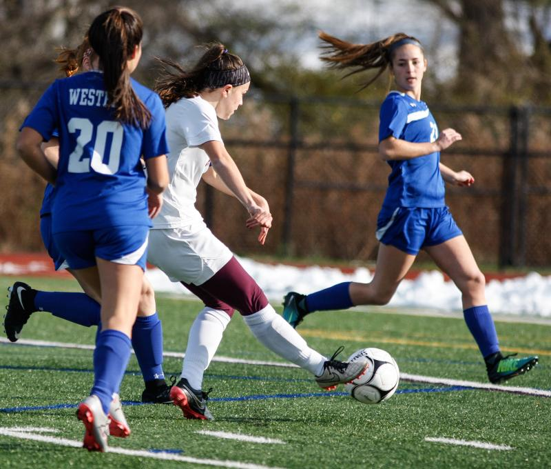 Aquinas Institute's Alana Piano (1) puts a shot on goal to score against Westhill in the first half of the  NYSPHSAA Class B Championship match Nov. 12 in Cortland. After playing  two 10-minute overtimes and two five-minute sudden victory overtimes, the match ended in a 2-2 draw and both teams were named Class B cochampions. (Courier photo by John Haeger)