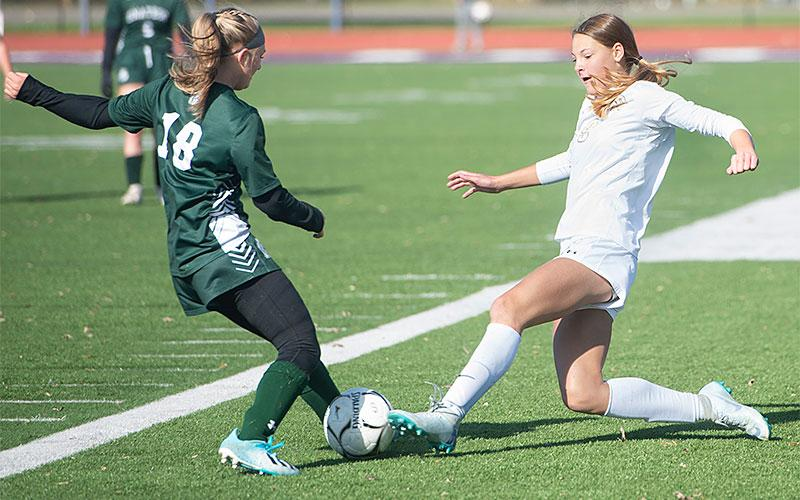 Unatego's Hannah Brandow (18) and Elmira Notre Dame's Shannon Maloney (9) work for control of the ball in the Section 4 Class C girls' soccer final in Norwich Nov. 2. Unatego won the match 1-0.