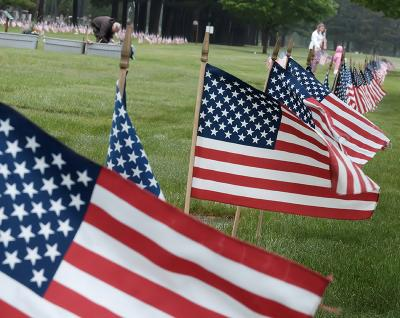 Flags wave in the wind at veterans' headstones in Rochester's Holy Sepulchre Cemetery May 25. Members of Boy Scout Troop 135 will place 5,300 flags at the graves of veterans as part of their annual Memorial Day America Flag placement project.
