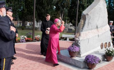 Bishop Salvatore R. Matano blesses the First Responders monument at Holy Sepulchre Cemetery in Rochester during a dedication ceremony Sept. 9.