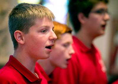 Jake Bakke, Tristan Wellman and Alex Hansen sing with fellow members of Land of Lakes Choirboys during a June 25 Mass at St. Mary Church in Auburn.
