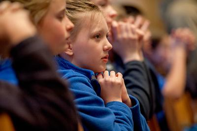 Allison Nordman, a sixth-grader at All Saints Academy in Corning, joins her classmates in prayer during the 2016 Catholic Schools Week Mass at Sacred Heart Cathedral, Rochester.