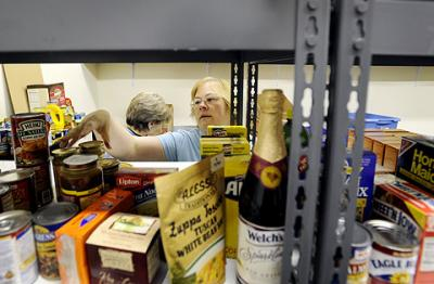 Sasha Stafford gathers items for food boxes at Spencerport Ecumenical Food Shelf in 2009.