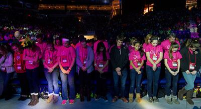 Pilgrims from the Diocese of Rochester bow their heads to receive a blessing from Bishop Christopher J Coyne, Auxiliary Bishop of Indianapolis, at the end of the opening ceremony of the National Catholic Youth Conference Nov. 21 at Lucas Oil Stadium in Indianapolis.
