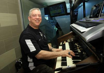 New York Yankees organist Paul Cartier poses for a photo during a Major League Baseball game between the Yankees and the Toronto Blue Jays at Yankee Stadium in the Bronx, N.Y., April 8. Cartier is also an organist for the National Hockey League's New York Islanders and at Our Lady of Hope Parish in Carle Place, N.Y.