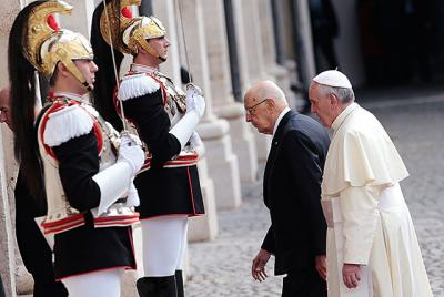 Italy's President Giorgio Napolitano and Pope Francis arrive for the pope's first state visit to the Quirinal presidential palace in Rome Nov. 14.