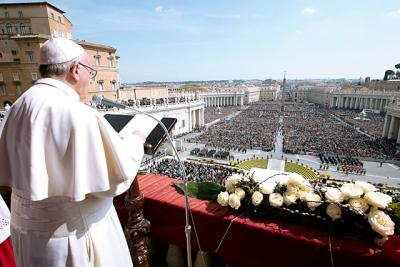 Pope Francis delivers his Easter message from the central balcony of St. Peter's Basilica at the Vatican March 27.