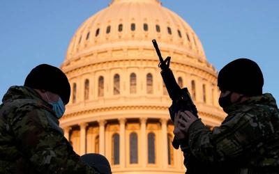 <p>A member of the National Guard holds a weapon at the U.S. Capitol in Washington Jan. 13, before Congress opened debate on one article of impeachment against President Donald Trump. (CNS photo by Joshua Roberts/Reuters)  </p>