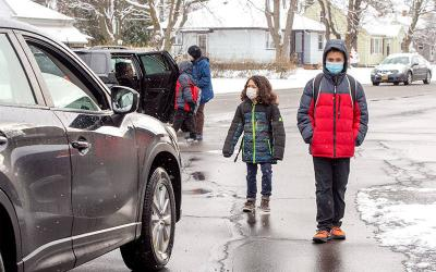 <p>Leo (left) and Isaac Weaver leave Rochester's St. Ambrose Academy at the end of the school day Jan. 22. </p>