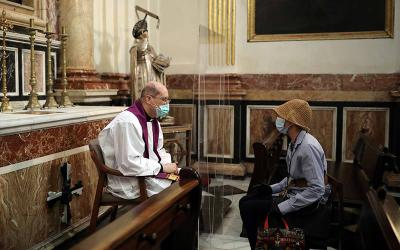 <p>A priest hears confession inside the cathedral in Valencia, Spain, May 19, 2020, amid the coronavirus pandemic. For the Christian, fasting during Lent is ultimately about fasting from sin. (CNS photo by Nacho Doce/Reuters)  </p>
