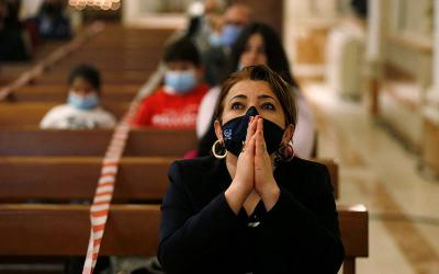 <p>A woman wearing a protective mask prays during Mass at the Church of the Sacred Heart in Amman, Jordan, Dec. 6, 2020, during the COVID-19 pandemic. It is inarguable that this Lent meets us in a place of profound personal and communal suffering and loss, of unending uncertainty and anxiety, of unanswered prayers. (CNS photo by Muhammad Hamed/Reuters)  </p>