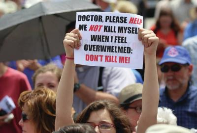 <p>CNS photo by Art Babych A woman holds a sign during a rally against physician-assisted suicide in Ottawa, Ontario. Through the Catholic Action Network, New York&rsquo;s bishops are urging Catholics to oppose a state bill to legalize physician-assisted suicide.  </p>