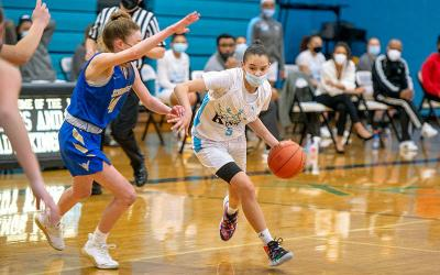 <p>Bishop Kearney&rsquo;s Amaia Jackson carries the ball in the first half of the March 10 girls basketball sectional semifinals game against Webster-Schroeder. (Courier photo by Jeff Witherow)  </p>