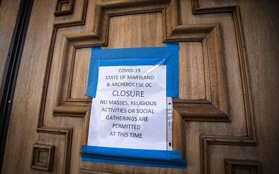 <p>A sign on the door of St. Mary&rsquo;s Catholic Church in Landover Hills, Md., alerts the public there will be no Sunday Mass March 22, 2020. The U.S. Conference of Catholic Bishops&rsquo; Administrative Committee released a pastoral message March 9, 2021, marking one year since the coronavirus pandemic &ldquo;changed life&rdquo; and &ldquo;ushered in suffering&rdquo; in the United States. (CNS photo by Chaz Muth)  </p>