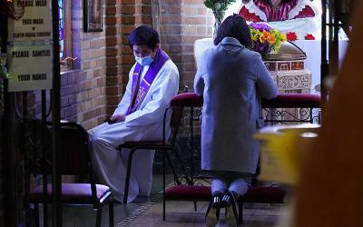 <p>Father Jiha Lim listens to a penitent&rsquo;s confession March 7, 2021, at St. Aloysius Church in Great Neck, N.Y., during the COVID-19 pandemic. The Vatican says general absolution still is permissible where infections continue to rise. (CNS photo by Gregory A. Shemitz)  </p>