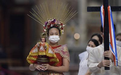 <p>People participate in a procession as Pope Francis celebrates a Mass marking the 500th anniversary of Christianity in the Philippines, in St. Peter&rsquo;s Basilica at the Vatican, March 14, 2021. (CNS photo by Cristian Gennari/pool)  </p>
