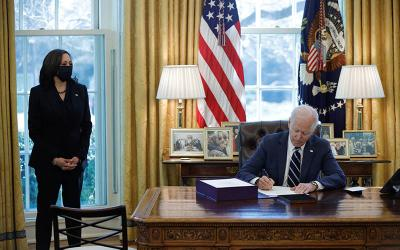 <p>President Joe Biden signs the American Rescue Plan into law at the White House in Washington March 11, 2021. The $1.9 trillion plan includes economic relief measures to respond to the impact of the coronavirus pandemic. Also pictured is Vice President Kamala Harris. (CNS photo by Tom Brenner/Reuters)  </p>