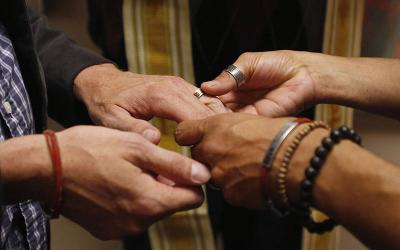 <p>A same-sex couple is pictured in a file photo exchanging rings during a ceremony in Salt Lake City. The Vatican&rsquo;s doctrinal office says in a new note that any form of blessing of same-sex unions is &ldquo;illicit,&rdquo; but that the negative judgment is on the blessing of unions, not the people, who must be respected. (CNS photo by Jim Urquhar/Reuters)  </p>