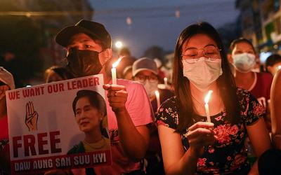<p>People hold candles as they take part in an anti-coup night protest at Hledan junction in Yangon, Myanmar, March 14, 2021. Pope Francis on March 17 appealed for an end to violence and the start of dialogue in Myanmar, where security forces have killed at least 138 people. (CNS photo by Reuters)  </p>
