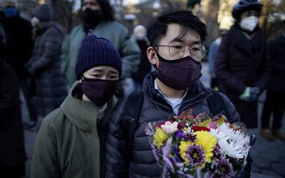 <p>People in New York City attend a peace vigil March 19, 2021, following the deadly shootings March 16 at three Asian day spas in metro Atlanta. (CNS photo by Eduardo Munoz/Reuters)  </p>
