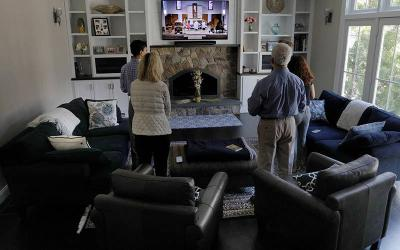 <p>The Lando family of Carlisle, Mass., participate in St. Mary&rsquo;s Catholic Church livestreamed Easter Mass April 12, 2020, during the coronavirus pandemic. (CNS photo by Brian Snyder/Reuters)  </p>