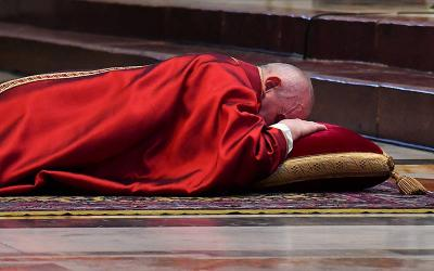 <p>Pope Francis lies prostrate as he leads the Good Friday Liturgy of the Lord&rsquo;s Passion April 2, 2020, at the Altar of the Chair in St. Peter&rsquo;s Basilica at the Vatican. (CNS photo by Andreas Solaro/pool via Reuters)  </p>