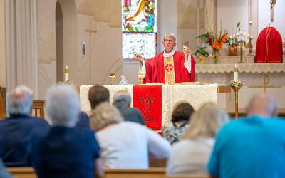 <p> Father Timothy Horan celebrates Mass on Pentecost Sunday May 23 at Holy Trinity Church in Webster. </p>