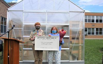 <p>Karen Jennings and Neal Moore are seen during the dedication of the greenhouse at Elmira Notre Dame High School May 6. (Photo courtesy of Elmira Notre Dame High School)  </p>