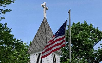 <p>The American flag at St. Stanislaus Church in Bradford, Steuben County, is seen after being remounted to the flagpole. (Photo courtesy of Father Patrick Connor)  </p>