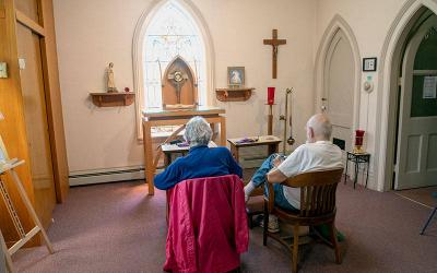 <p>Milton and Dee Dries pray in the adoration chapel at St. Joseph Church in Rush May 20. </p>