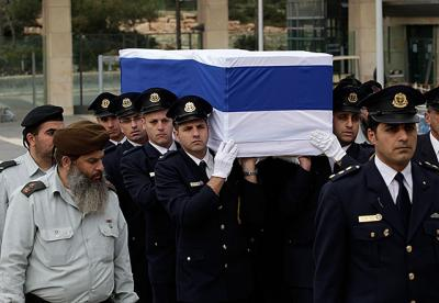 Members of the Knesset guard Jan. 12 carry the flag-draped coffin with the body of former Israeli Prime Minister Ariel Sharon to the Knesset, Israel's parliament, in Jerusalem, where he lay in state before his funeral. Sharon, who had been in a coma for eight years after he had a stroke at the height of his power, died Jan. 11 at age 85.