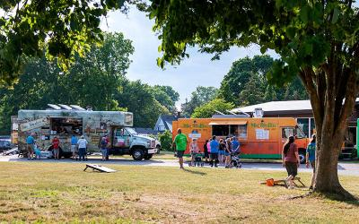 <p>Food trucks line the driveway at St. Rita Church in Webster during a June 26 Food Truck Rodeo. (Courier photo by Jeff Witherow)  </p>