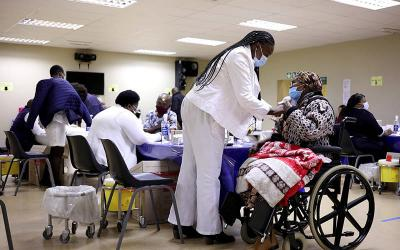 <p>Elderly people in Johannesburg receive a dose of the coronavirus vaccine May 17, 2021. Archbishop Jos&#233; H. Gomez of Los Angeles, president of the U.S. Conference of Catholic Bishops, and Bishop David J. Malloy of Rockford, Ill., chairman of the USCCB Committee on International Justice and Peace, commended President Joe Biden June 23 for his commitment to provide 500 million COVID-19 vaccines to lower-income countries. (CNS photo by Siphiwe Sibeko/Reuters)  </p>