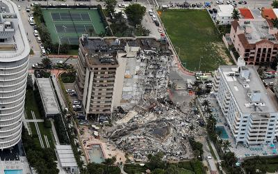 <p>An aerial view shows a partially collapsed building in Surfside, Fla., just north of Miami Beach, June 24, 2021. (CNS photo by Marco Bello/Reuters)  </p>