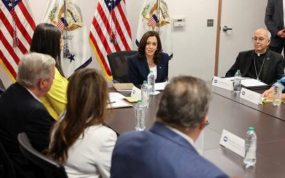 <p>U.S. Vice President Kamala Harris takes part in a roundtable discussion at Paso del Norte Port of Entry in El Paso, Texas, June 25, 2021, with faith and community leaders who are assisting with the processing of migrants seeking asylum. At the right is Bishop Mark J. Seitz of El Paso. (CNS photo by Evelyn Hockstein/Reuters)  </p>