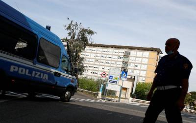 <p>An Italian police officer stands outside Gemelli hospital in Rome where Pope Francis had a prescheduled colon surgery July 4. (CNS photo/ by Guglielmo Mangiapane/Reuters)  </p>