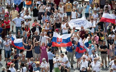 <p>Pilgrims holding the Slovak flag cheer in St. Peter&rsquo;s Square at the Vatican July 4, 2021, as Pope Francis announces he will visit their country Sept. 12-15 after stopping in Budapest, Hungary, to celebrate the closing Mass of the International Eucharistic Congress. (CNS photo by Vatican Media)  </p>