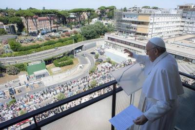 <p>Pope Francis greets the crowd as he leads the Angelus from a balcony of Gemelli hospital in Rome July 11, 2021, as he recovers following scheduled colon surgery. (CNS photo by Vatican Media via Reuters)  </p>