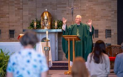 <p>Father John Firpo leads a teaching Mass at St. Charles Borromeo Church in Greece July 14. (Courier photo by Jeff Witherow)</p>
