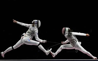 <p> Lee Kiefer of the United States, right, competes against Larisa Korobeynikova of the Russian Olympic Committee in the semifinal of the 2020 Tokyo Olympics women's individual foil competition July 25, 2021. Kiefer went on the same day to win the gold medal by defeating defending champion Inna Deriglazova 15-13 in the final. </p>
