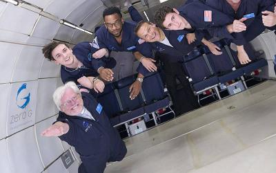 <p>Deacon Gary Nosacek of the Archdiocese of Milwaukee, far left, experiences weightlessness with others aboard a Zero Gravity Corp. flight July 11, 2021, over the Nevada landscape. (CNS photo courtesy Zero Gravity Corp.)  </p>