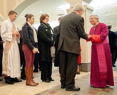 Bishop Salvatore R. Matano talks with local Catholics after solemn vespers at Sacred Heart Cathedral Jan. 2. As shepherd of the diocese, a bishop is called to be present in parishes and the wider community. (Courier photo by Mike Crupi)