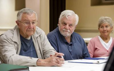<p>Jack Gromniak (from left), Tom Reichold and Barb Frauenhofer attend a meeting of Stephen ministers Oct. 4 at St. Patrick Church in Owego.  </p>