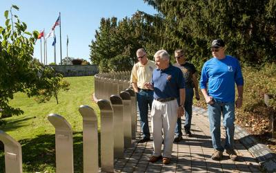<p>Vietnam veterans Jerry McDermott (from left), Chuck Macaluso, Stan Patykiewicz and Ron Trovato walk the grounds of the Vietnam Memorial in Rochester&rsquo;s Highland Park Oct. 20.  </p>