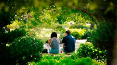 """Two friends take advantage of a shady spot in the Japanese Friendship Garden in Phoenix. Even before the time of Christ, Aristotle wrote beautifully on the subject of friendship. Many are familiar with a phrase of his composing, a friend is """"a single soul in two bodies."""" (CNS photo by Nancy Wiechec)"""
